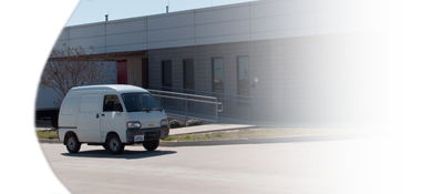 Low speed delivery vehicle in front of the MMAC Mail & Distribution center.
